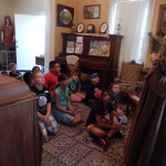 Docent talking in parlor