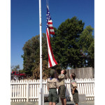 Boy Scouts raising US flag