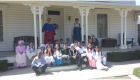 Students sitting on front porch with 'Mr. and Mrs. Byer'