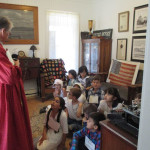 Students listening to Docent on House Tour