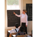 Teacher pointing to words to morning song